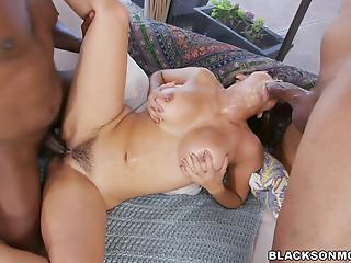 MILF in short blue dress is fucking with two big black sausages