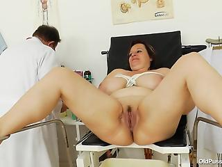 Fatty mature brunette presents her massive boobs and pussy