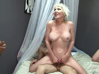 Three young men with big cocks fuck a busty cougar blonde