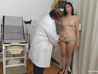 Nasty old gynecologist is playing with a hairy pussy of a mature