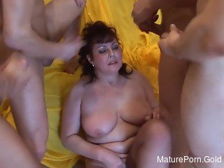 Nasty youngsters are double penetrating a lustful big-boobed MILF