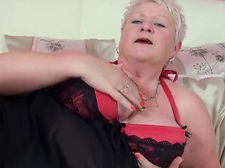 Fat BBW in black stockings plays with her wide-opened snatch