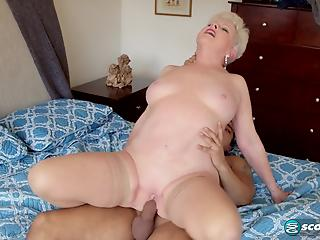 Sex-addicted mature blonde bangs with young man in cowgirl pose