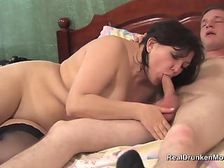 Older lady in black stockings bangs with a much younger man