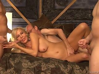 All-natural blonde MILF and three horny man in group sex XXX