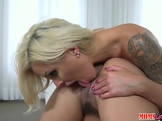 Awesome glamour MILF with tattoos fucks her younger girlfriend in the bed