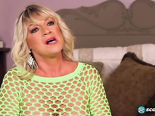 Fake-boobed MILF in green mesh pleases her younger fucker with love