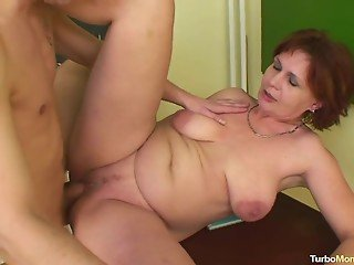 Crazy lustful teacher with saggy boobs jumps on a stud's cock
