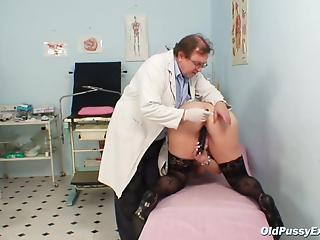 Filthy doctor is playing with a tight pussy of a real mature BBW