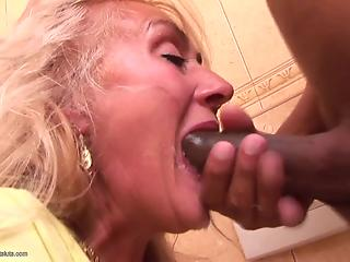 Black man and cock-eating white mommy in face fucking XXX action