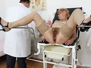 Nasty-minded doctor explores hairy pussy of a sweet mature