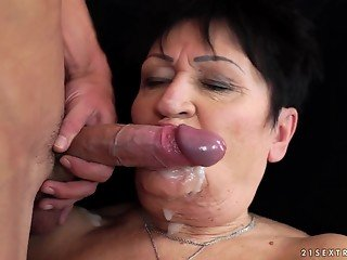 Muscled young man cums on the face of a lustful amateur BBW