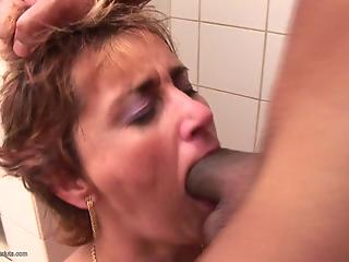 Black man fucks a face of a dick-swallowing amateur MILF