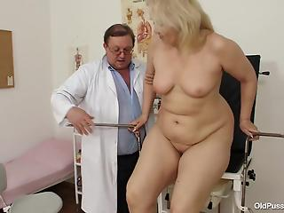Perverted doctor treats tight pussy of a big-boobed mature