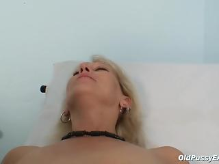 Sexy blondie MILF with shaved pussy gets treated by gynecologist