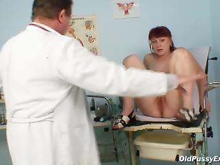 Redhead with long tailed spreads legs for old gynecologist