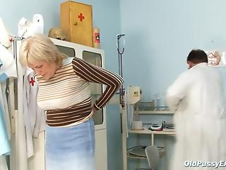 Fat gynecologist does several tests on pussy of pretty granny