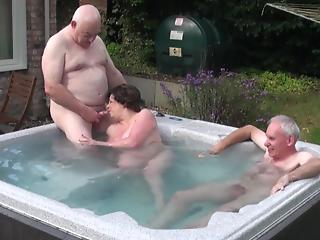 Dirty granny relaxes in pool together with two old gentlemen