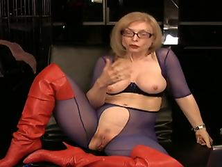 Mature hottie in blue bodystocking is playing with a huge vibrator