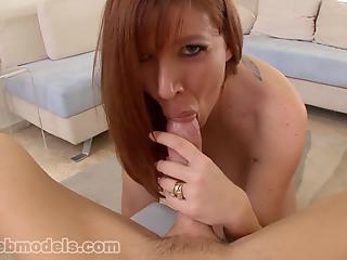 Redhead housewife with big boobs swallows the load in POV mode
