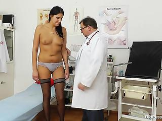 Big-boobed housewife in black stockings and a nasty doctor