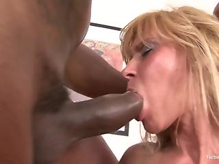 Golden cougar in black stockings is trying big black sausage