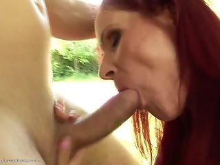 Sparkling redhead MILF is getting nicely creampied on the grass