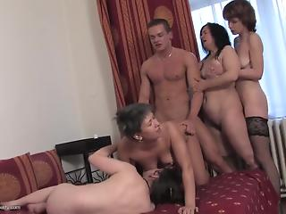 Four partying MILFs and young muscled male in reverse gangbang