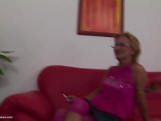 Mature blonde in glasses jumps on a hard prick of a younger man