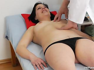 Nasty doctor is playing with a wide-opened pussy of a brunette...