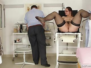 Fatty patient in stockings spreads legs for curious gynecologist