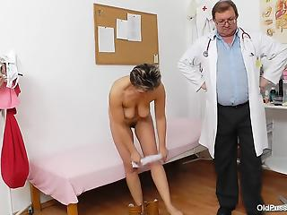 Skillful gynecologist examines pussy of short-haired patient