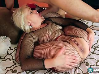 Granny in fishnet bodystocking is assfucked in bedroom