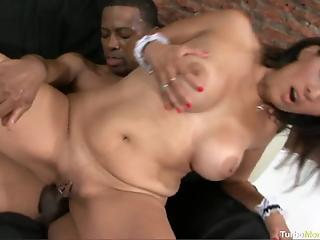 Black guy fucks classy Latina MILF on sofa and cums on her chest