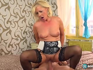 Stockings-clad blonde MILF gets fucked doggy style