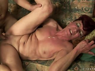 Leathery MILF getting fucked by her younger partner