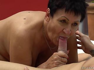 Short-haired granny rubbed and railed by a young stud
