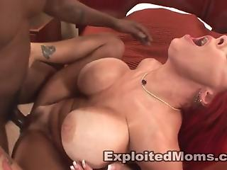 Redheaded mommy with big fake tits gets blacked