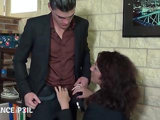 Dark-haired MILF fucking a confident young stud
